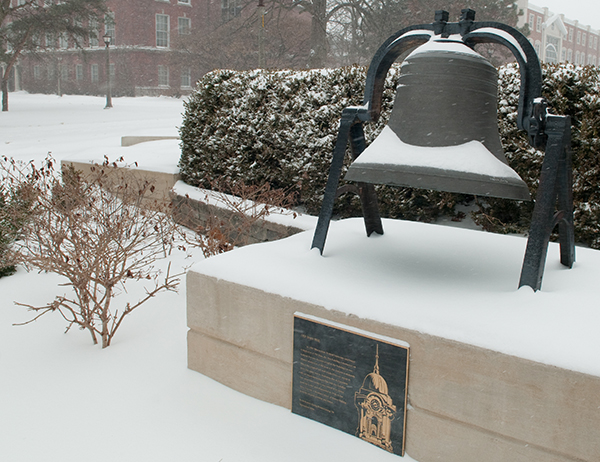 snow covered Old Main Bell